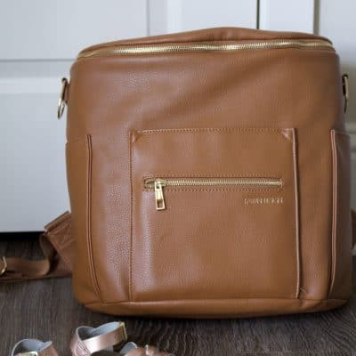 My Fawn Design diaper bag review! All about the popular backpack diaper bag made of faux leather with gold hardware. Read why I think this trendy faux leather diaper bag is carried by so many stylish mamas!